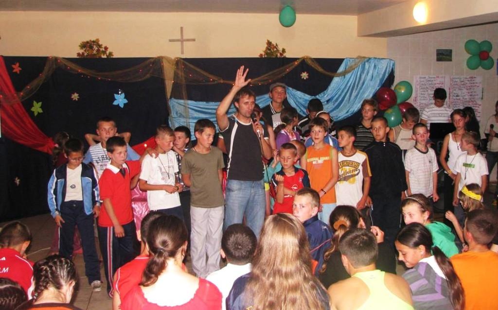 Ion Cotorobai praying for campers